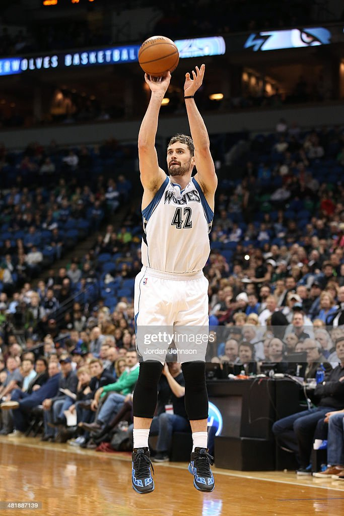 Kevin Love #42 of the Minnesota Timberwolves shoots the ball during the game against the Milwaukee Bucks on March 11, 2014 at Target Center in Minneapolis, Minnesota.