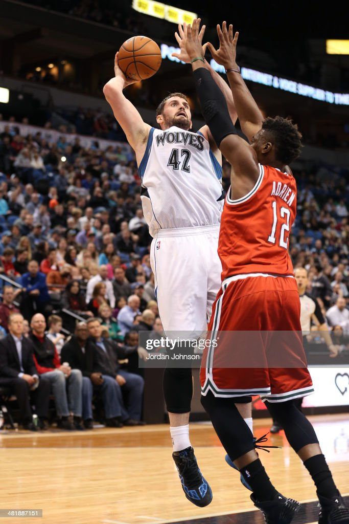 <a gi-track='captionPersonalityLinkClicked' href=/galleries/search?phrase=Kevin+Love&family=editorial&specificpeople=4212726 ng-click='$event.stopPropagation()'>Kevin Love</a> #42 of the Minnesota Timberwolves shoots the ball during the game against the Milwaukee Bucks on March 11, 2014 at Target Center in Minneapolis, Minnesota.