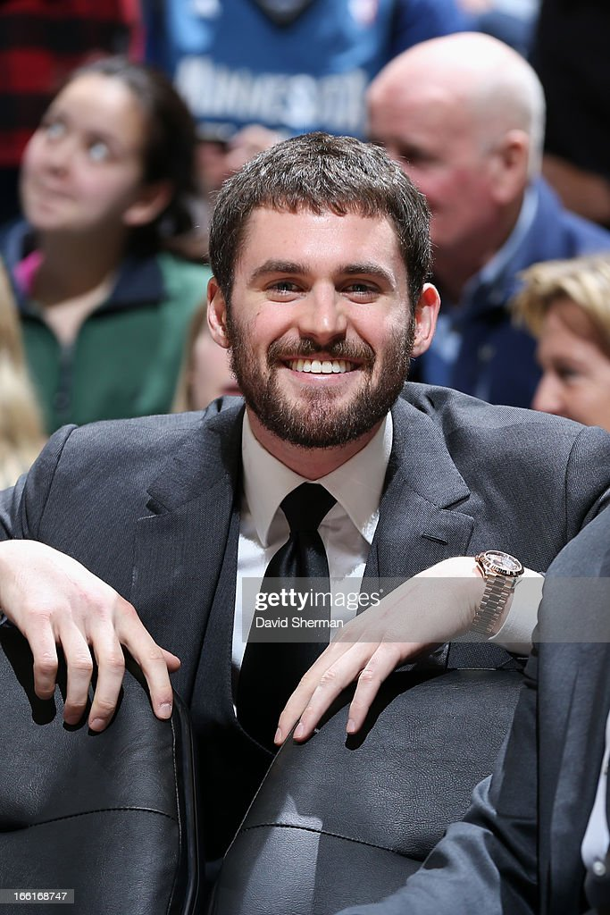 Kevin Love #42 of the Minnesota Timberwolves smiles from the bench during the game against the Miami Heat on March 4, 2013 at Target Center in Minneapolis, Minnesota.
