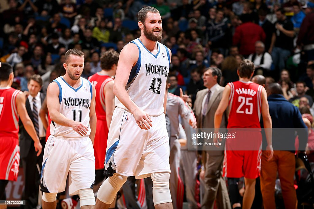 Kevin Love #42 of the Minnesota Timberwolves smiles while walking to the sideline against the Houston Rockets on December 26, 2012 at Target Center in Minneapolis, Minnesota.