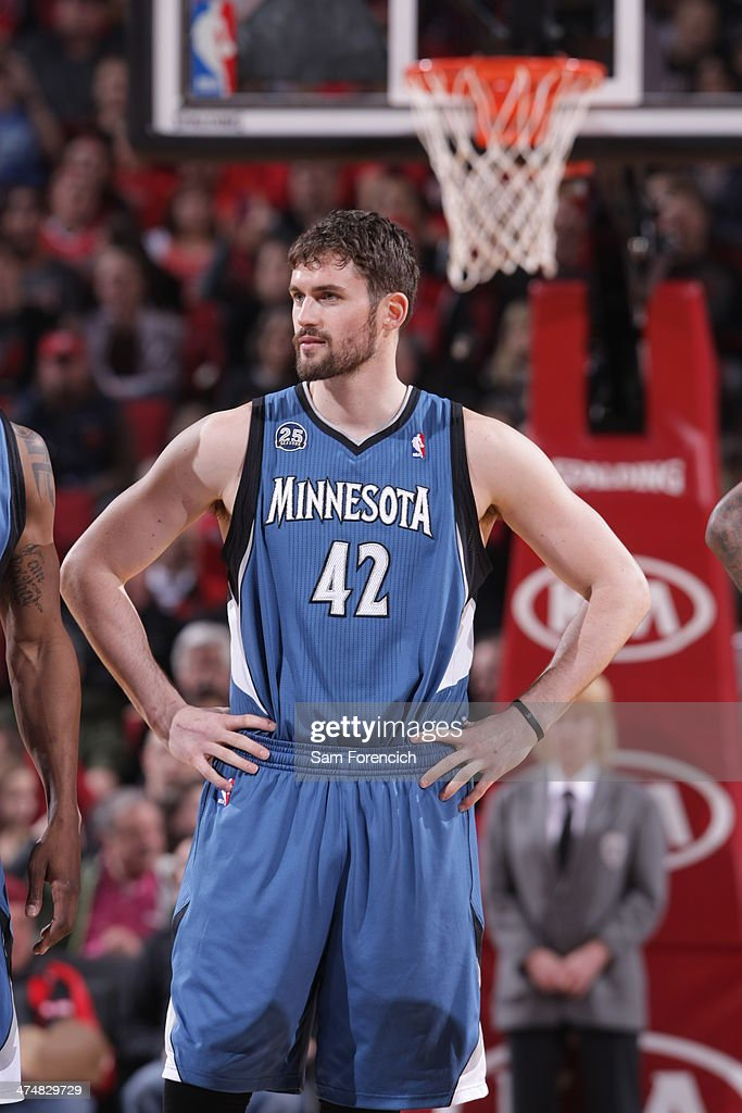 Kevin Love #42 of the Minnesota Timberwolves stands on the court before the game against the Portland Trail Blazers on February 23, 2014 at the Moda Center Arena in Portland, Oregon.