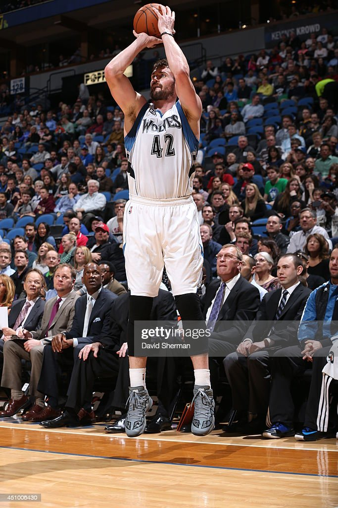 <a gi-track='captionPersonalityLinkClicked' href=/galleries/search?phrase=Kevin+Love&family=editorial&specificpeople=4212726 ng-click='$event.stopPropagation()'>Kevin Love</a> #42 of the Minnesota Timberwolves takes a shot against the Los Angeles Clippers on March 31, 2014 at Target Center in Minneapolis, Minnesota.