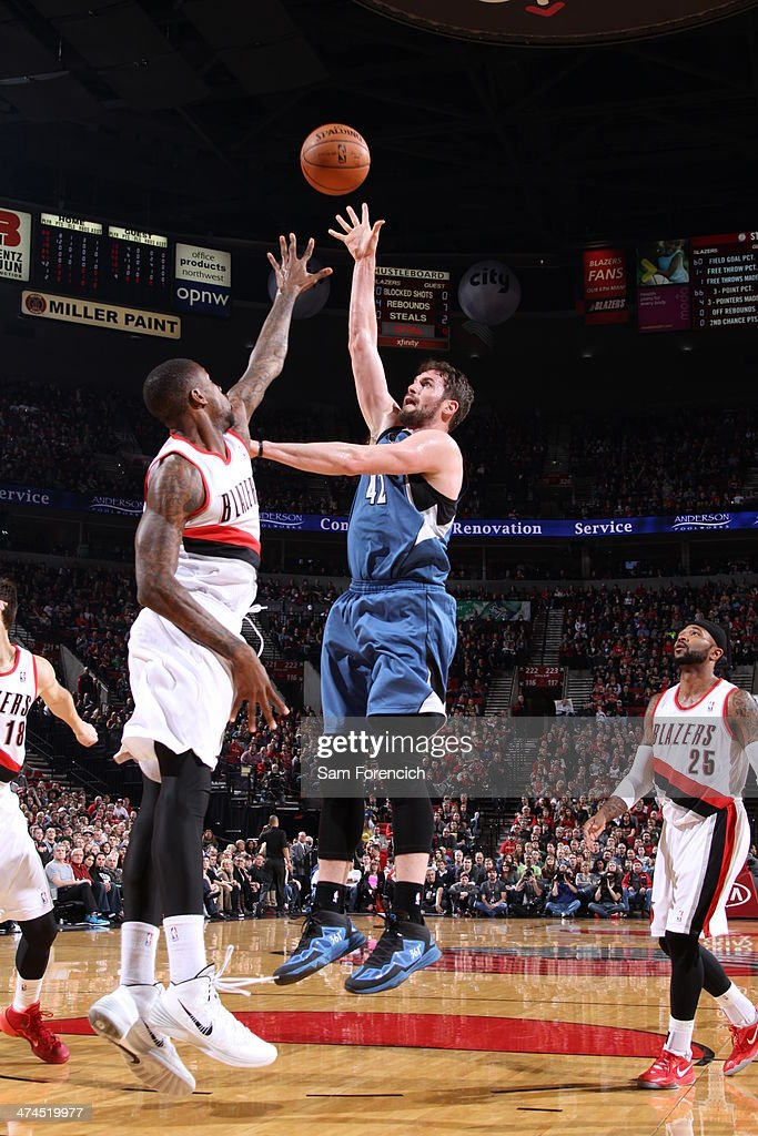 Kevin Love #42 of the Minnesota Timberwolves takes a shot during a game against the Portland Trail Blazers on February 23, 2014 at the Moda Center Arena in Portland, Oregon.