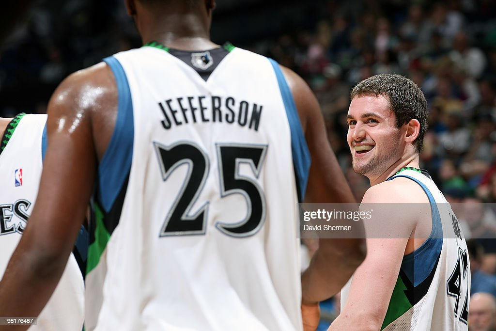 Kevin Love #42 shares a laugh with teammate Al Jefferson #25 of the Minnesota Timberwolves during the game against the Sacramento Kings on March 31, 2010 at the Target Center in Minneapolis, Minnesota.