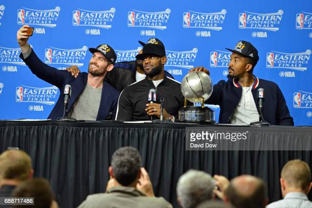 Kevin Love Tristan Thompson LeBron James and JR Smith of the Cleveland Cavaliers 'take a selfie' during a press conference after winning Game Five of...