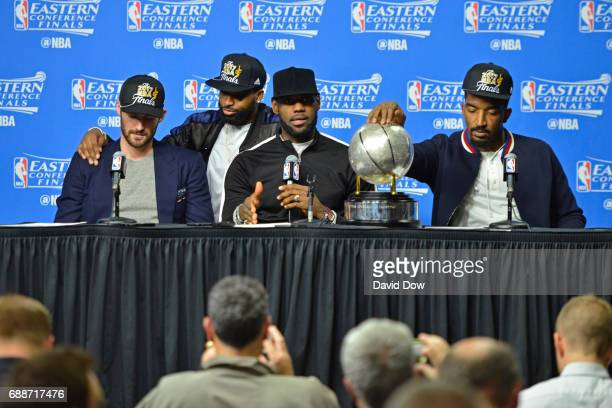 Kevin Love Tristan Thompson LeBron James and JR Smith of the Cleveland Cavaliers talk to the media during a press conference after winning Game Five...