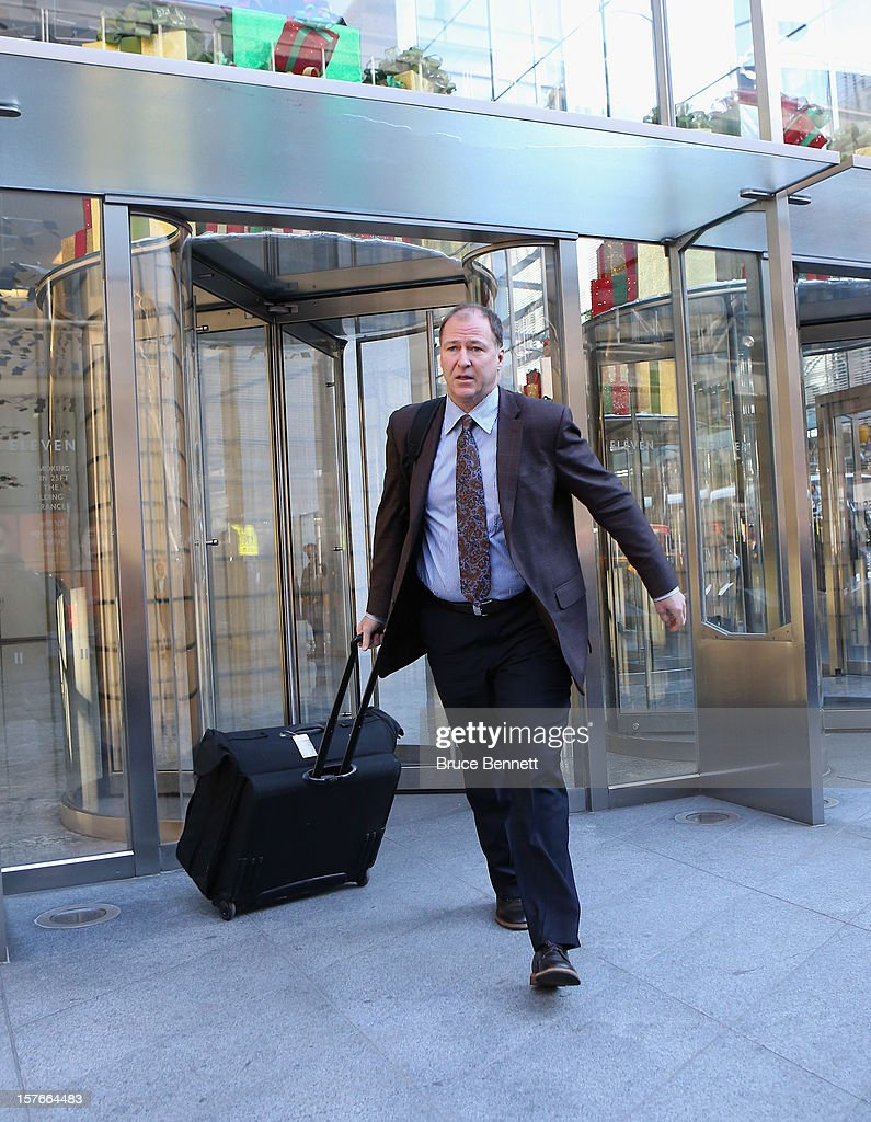 Kevin Lowe, President of Hockey Operations for the Edmonton Oilers leaves the leagues legal offices following the National Hockey League Board of Governors meeting on December 5, 2012 in New York City.