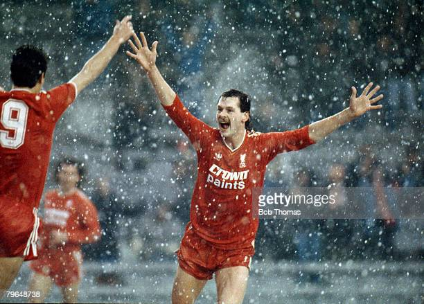 Kevin MacDonald of Liverpool celebrates with Ian Rush after scoring the first goal in Liverpool's FA Cup third round game with Norwich City at...