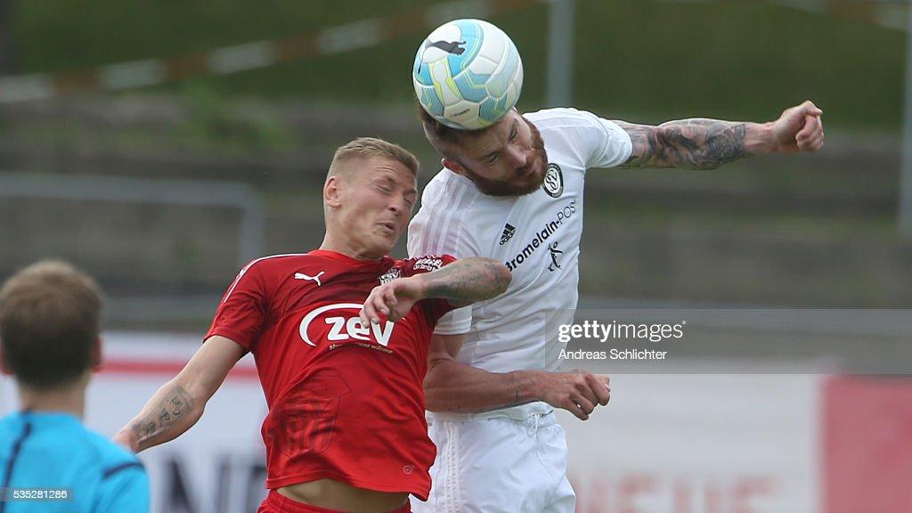 Kevin Maek of Elversberg challenges Marc-Philipp Zimmermann of Zwickau during Regionalliga Playoffs match between FSV Zwickau and SV Elversberg on May 25 on May 29, 2016 in Plauen, Germany.
