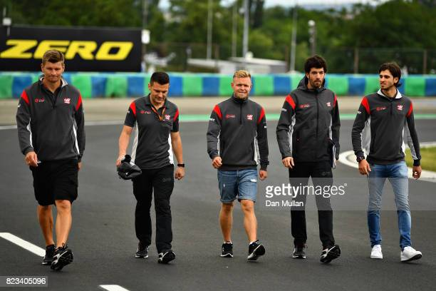 Kevin Magnussen of Denmark and Haas F1 walks the circuit with his engineers during previews ahead of the Formula One Grand Prix of Hungary at...