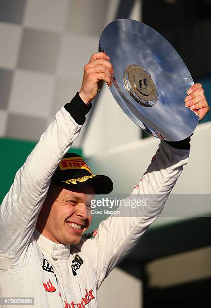 Kevin Magnussen of Denmark and McLaren celebrates on the podium after finishing third during the Australian Formula One Grand Prix at Albert Park on...