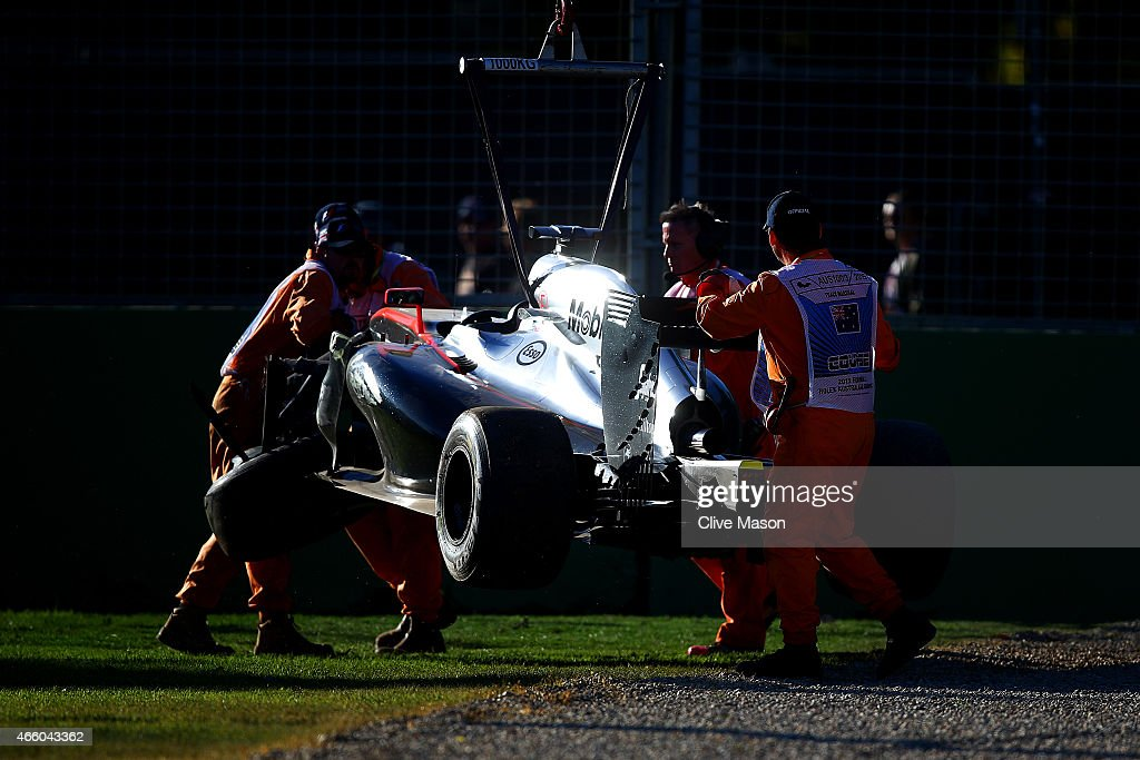 Kevin Magnussen of Denmark and McLaren Honda's car is lifted off the track after he crashed during practice for the Australian Formula One Grand Prix at Albert Park on March 13, 2015 in Melbourne, Australia.