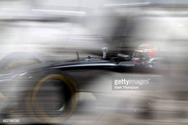 Kevin Magnussen of Denmark and McLaren makes a pit stop during the Hungarian Formula One Grand Prix at Hungaroring on July 27 2014 in Budapest Hungary