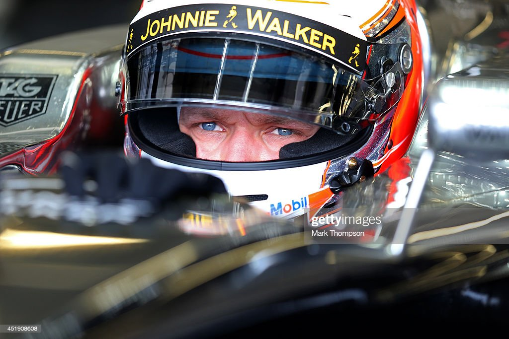 <a gi-track='captionPersonalityLinkClicked' href=/galleries/search?phrase=Kevin+Magnussen&family=editorial&specificpeople=7882003 ng-click='$event.stopPropagation()'>Kevin Magnussen</a> of Denmark and McLaren sits in his car in the garage during day two of testing at Silverstone Circuit on July 9, 2014 in Northampton, England.