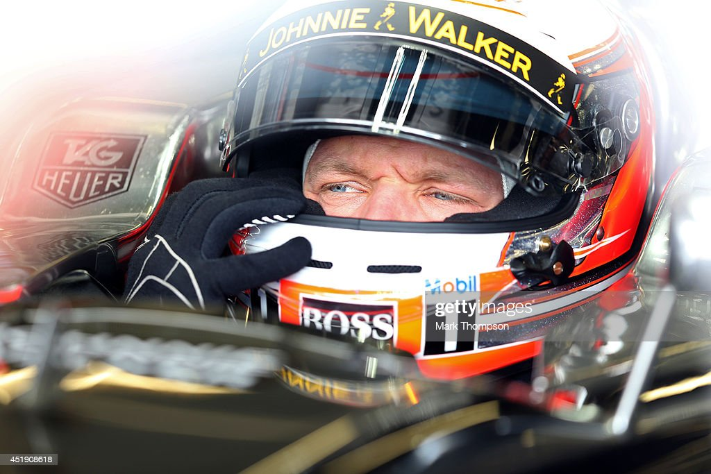 Kevin Magnussen of Denmark and McLaren sits in his car in the garage during day two of testing at Silverstone Circuit on July 9, 2014 in Northampton, England.