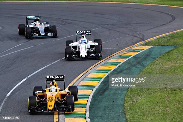 Kevin Magnussen of Denmark drives the Renault Sport Formula One Team Renault RS16 Renault RE16 turbo ahead of Felipe Massa of Brazil drives the...