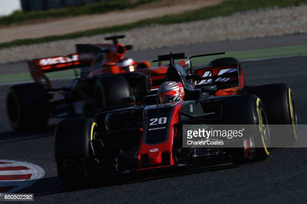 Kevin Magnussen of Denmark driving the Haas F1 Team HaasFerrari VF17 Ferrari leads Stoffel Vandoorne of Belgium driving the McLaren Honda Formula 1...