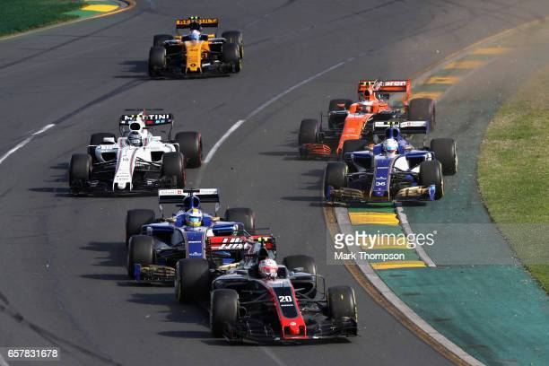 Kevin Magnussen of Denmark driving the Haas F1 Team HaasFerrari VF17 Ferrari Marcus Ericsson of Sweden driving the Sauber F1 Team Sauber C36 Ferrari...
