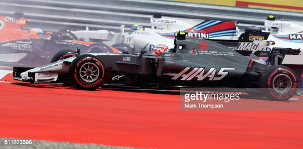 Kevin Magnussen of Denmark driving the Haas F1 Team HaasFerrari VF17 Ferrari after being caught up in a collision into turn one during the Formula...