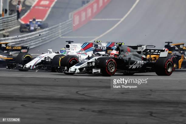Kevin Magnussen of Denmark driving the Haas F1 Team HaasFerrari VF17 Ferrari and Felipe Massa of Brazil driving the Williams Martini Racing Williams...