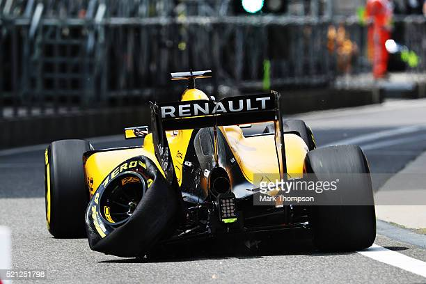 Kevin Magnussen of Denmark driving the Renault Sport Formula One Team Renault RS16 Renault RE16 turbo suffers a puncture on track during practice for...