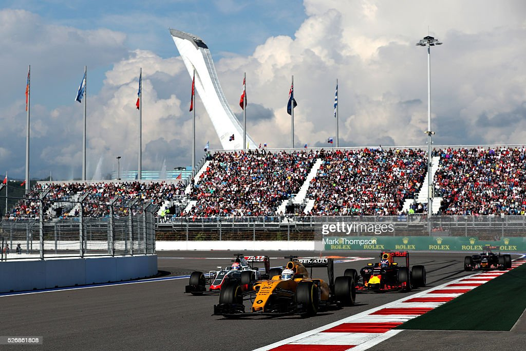 Kevin Magnussen of Denmark driving the (20) Renault Sport Formula One Team Renault RS16 Renault RE16 turbo on track ahead of Romain Grosjean of France driving the (8) Haas F1 Team Haas-Ferrari VF-16 Ferrari 059/5 turbo, and Daniel Ricciardo of Australia driving the (3) Red Bull Racing Red Bull-TAG Heuer RB12 TAG Heuer o during the Formula One Grand Prix of Russia at Sochi Autodrom on May 1, 2016 in Sochi, Russia.