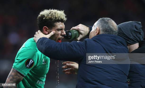 Kevin Malcuit of AS SaintEtienne receives treatment on a facial injury after a clash with Anthony Martial of Manchester United during the UEFA Europa...