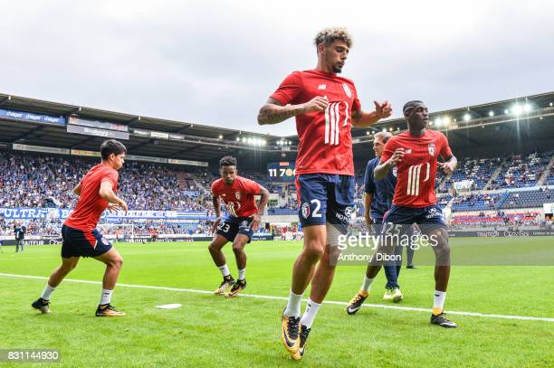 Kevin Malcuit of Lille and Fode Ballo of Lille during the Ligue 1 match between Racing Club Strasbourg and Lille OSC at Stade de la Meinau on August...