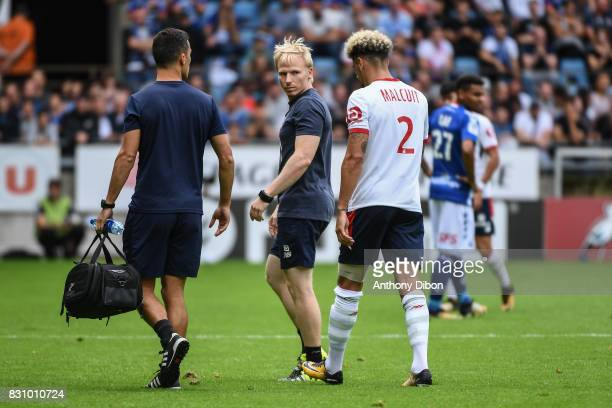 Kevin Malcuit of Lille goes out injured during the Ligue 1 match between Racing Club Strasbourg and Lille OSC at Stade de la Meinau on August 13 2017...