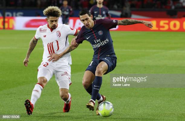 Kevin Malcuit of Lille OSC in action with Angel Di Maria of Paris SaintGermain during the Ligue 1 match between Paris Saint Germain and Lille OSC at...