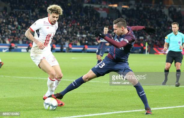 Kevin Malcuit of Lille OSC in action with Julian Draxler of Paris SaintGermain during the Ligue 1 match between Paris Saint Germain and Lille OSC at...
