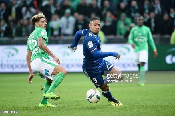 Kevin Malcuit of Saint Etienne and Memphis Depay of Lyon during the Ligue 1 match between As Saint Etienne and Olympique Lyonnais Lyon at Stade...