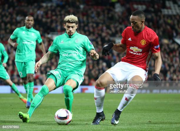 Kevin Malcuit of SaintEtienne and Anthony Martial of Manchester United in action during the UEFA Europa League Round of 32 first leg match between...