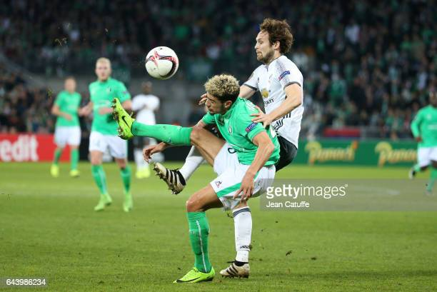 Kevin Malcuit of SaintEtienne and Daley Blind of Manchester United in action during the UEFA Europa League Round of 32 second leg match between AS...