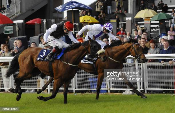 Kevin Manning crosses the line on Coolcullen Times to win Boylesports Fonabet 1800 44 00 00 Handicap during the Boylesportscom Irish 2000 Guineas Day...