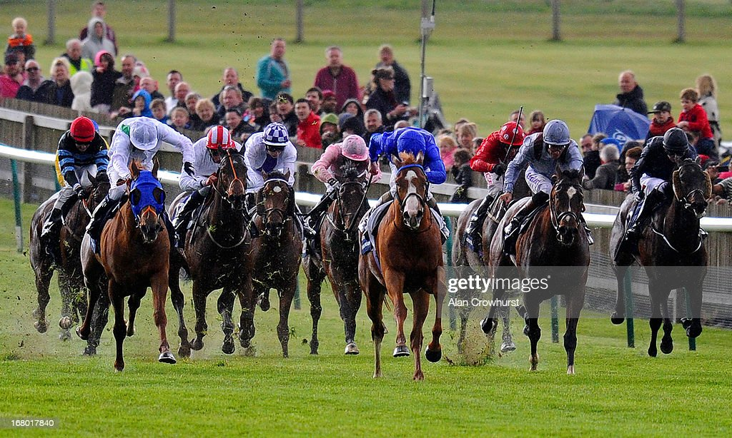 Kevin Manning riding Dawn Approach (C, blue) win The Qipco 2000 Guineas Stakes at Newmarket racecourse on May 04, 2013 in Newmarket, England.