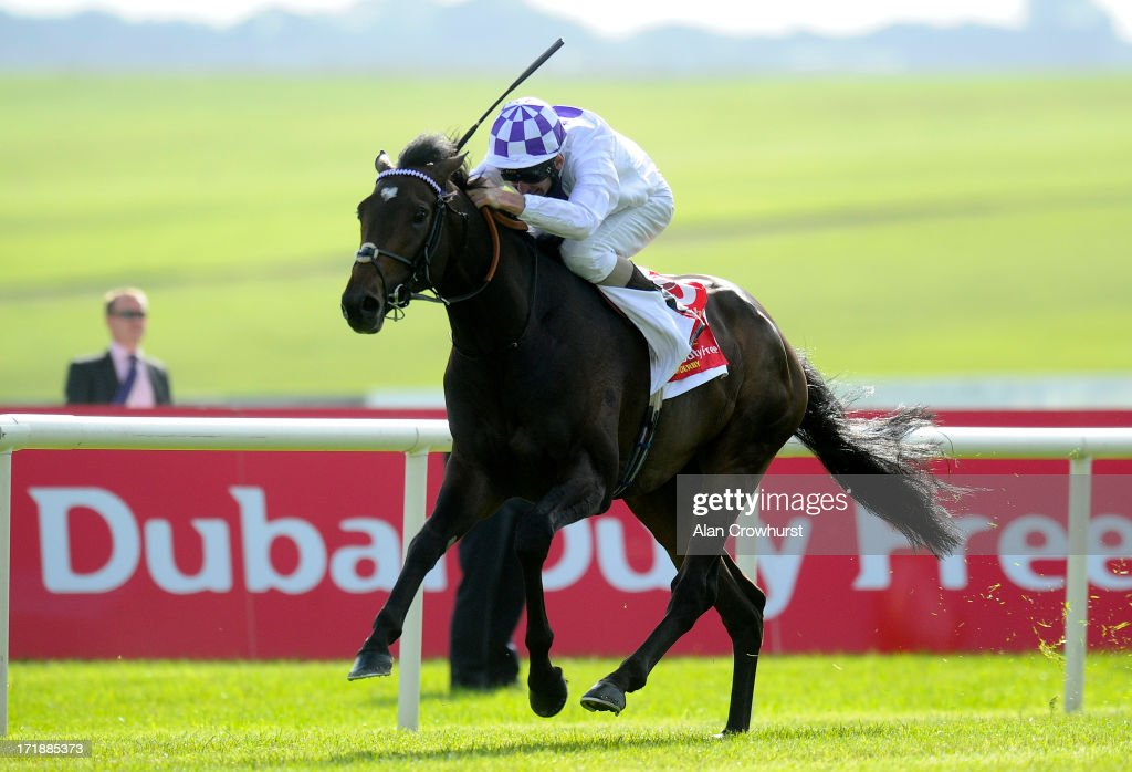 Kevin Manning riding Trading Leather win The Dubai Duty Free Irish Derby at Curragh racecourse on June 29 2013 in Kildare Ireland