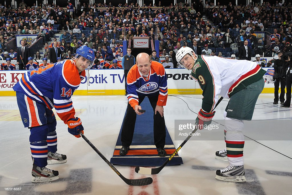 Kevin Martin of the Canadian Curling team drops the puck at Rexall Place prior to a game between the Edmonton Oilers and Minnesota Wild on February 21, 2013 at Rexall Place in Edmonton, Alberta, Canada.