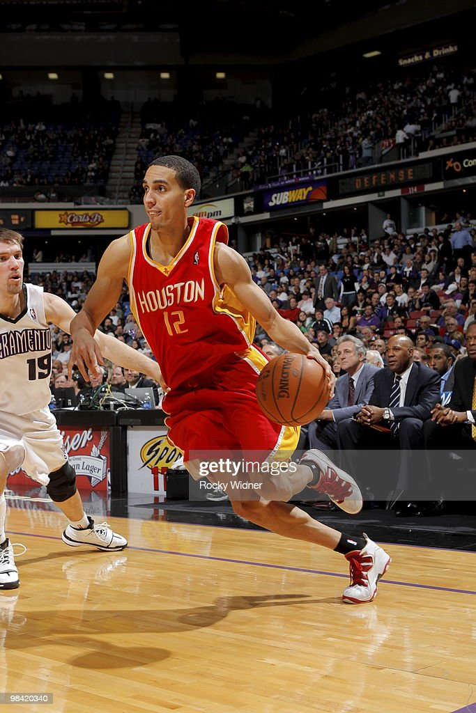 Kevin Martin of the Houston Rockets drives to the basket around Beno Udrih of the Sacramento Kings on April 12 2010 at ARCO Arena in Sacramento...