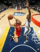 Kevin Martin of the Houston Rockets shoots a layup against Sam Young of the Memphis Grizzlies on January 21 2011 at FedExForum in Memphis Tennessee...