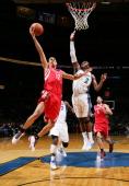 Kevin Martin of the Houston Rockets shoots against John Wall of the Washington Wizards at the Verizon Center on November 10 2010 in Washington DC...