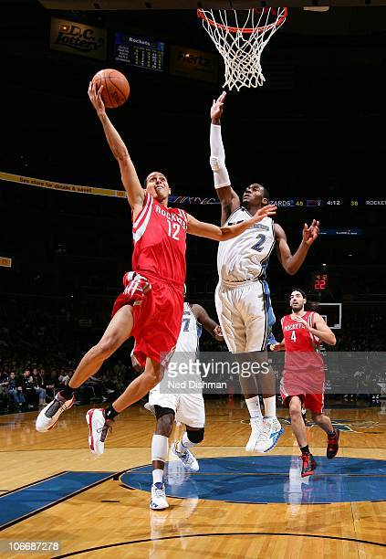 Kevin Martin of the Houston Rockets shoots against John Wall of the Washington Wizards at the Verizon Center on November 10 2010 in Washington DC...