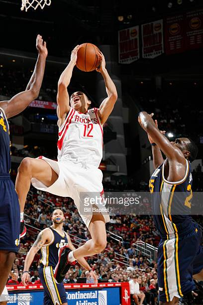 Kevin Martin of the Houston Rockets shoots the ball over Al Jefferson of the Utah Jazz on January 8 2011 at the Toyota Center in Houston Texas NOTE...