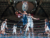 Kevin Martin of the Minnesota Timberwolves goes in for the layup against Dirk Nowitzki of the Dallas Mavericks on February 2 2015 at the American...