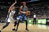 Kevin Martin of the Minnesota Timberwolves handles the ball against Danny Green of the San Antonio Spurs on March 15 2015 at the ATT Center in San...