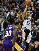 Kevin Martin of the Minnesota Timberwolves shoots a basket over Julius Randle and D'Angelo Russell of the Los Angeles Lakers during the fourth...