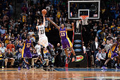 Kevin Martin of the Minnesota Timberwolves shoots against Louis Williams of the Los Angeles Lakers during the game on December 9 2015 at Target...