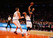 Kevin Martin of the Minnesota Timberwolves shoots against Shane Larkin of the New York Knicks during their game at Madison Square Garden on March 19...