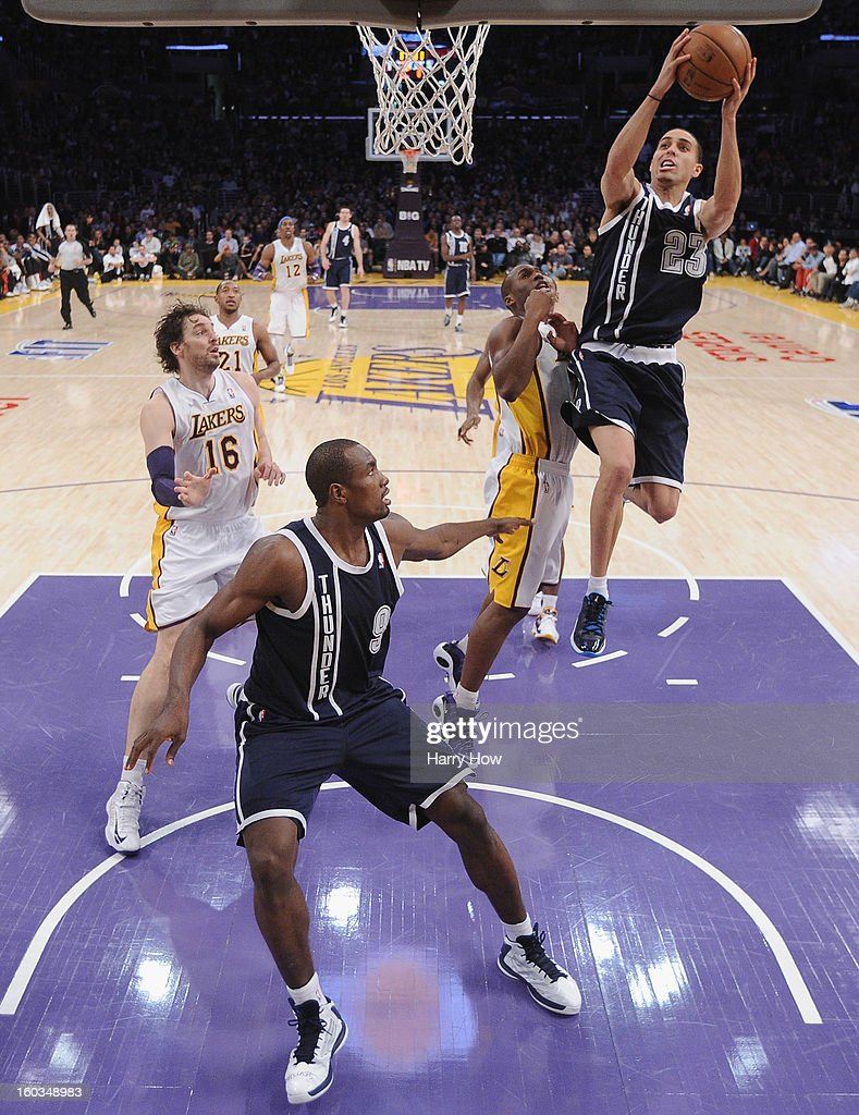 Kevin Martin #23 of the Oklahoma City Thunder attempts a layup in front of teammate Serge Ibaka #9 while Jodie Meeks #20 and Pau Gasol #16 of the Los Angeles Lakers look on at Staples Center on January 27, 2013 in Los Angeles, California.
