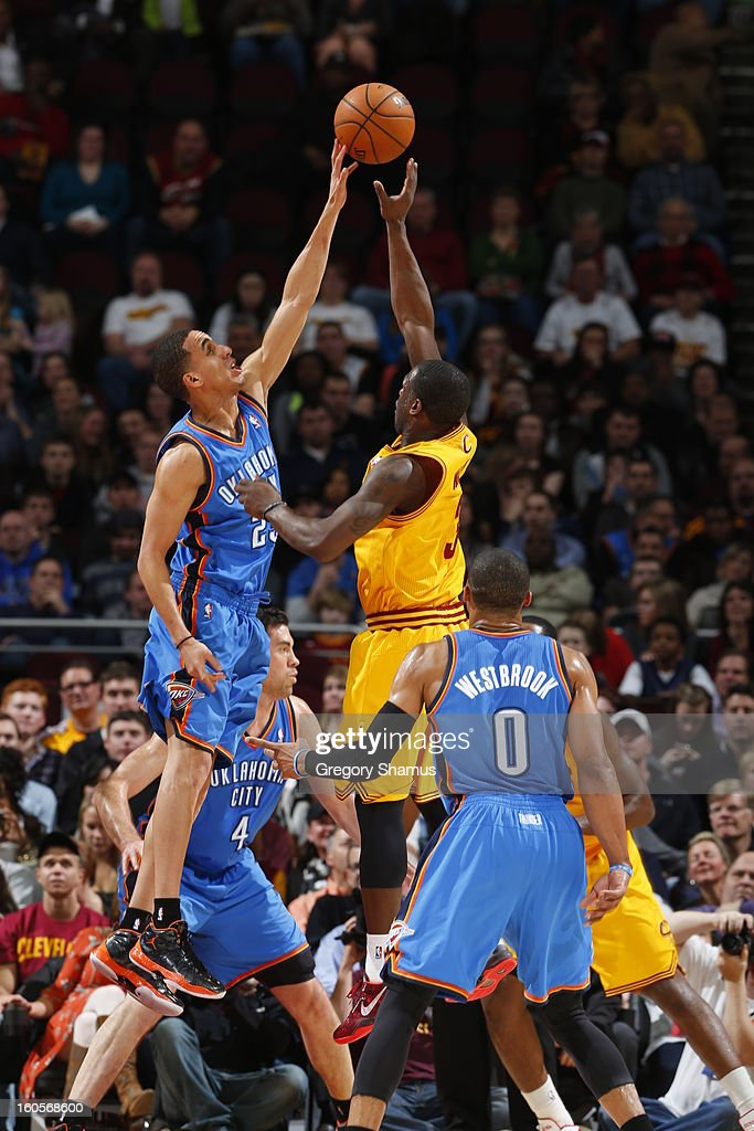Kevin Martin #23 of the Oklahoma City Thunder blocks a shot against Dion Waiters #3 of the Cleveland Cavaliers at The Quicken Loans Arena on February 2, 2013 in Cleveland, Ohio.
